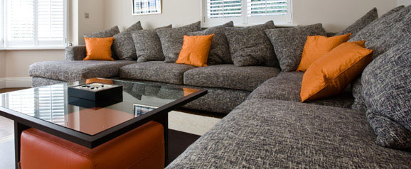 A bespoke sectional sofa designed to fit into a large family room, to accommodate a teenage family, friends and dogs.