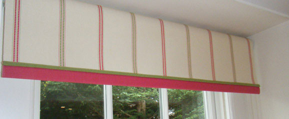 A laminated roller blind designed for a neutral kitchen, to maintain the clean lines but to add a dash of colour with piping in the complimentary colours of the fabric.