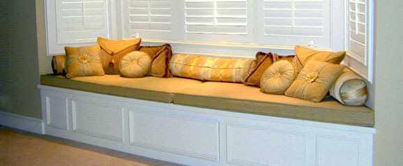 A window seat was designed and built to fill an alcove area in a master bedroom, to provide a comfortable relaxation area with a large range of cushions.